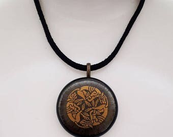 Celtic knotwork pendant, gold, bronze and black fused glass.