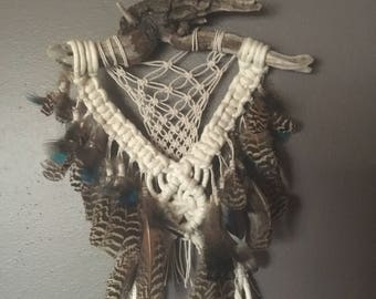 Macrame and feathers wall hanging