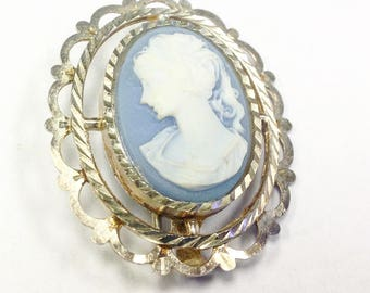Vintage cameo brooch in a Wedgwood blue.
