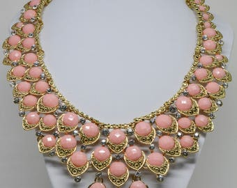 Stunning gold tone Necklace With pink Beads