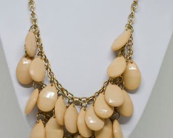 Lovely gold tone and plastic beads necklace