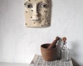 Small ceramic face, Dodomeki wall sculpture, female head with many tiny bird eyes from Louise Fulton Studio
