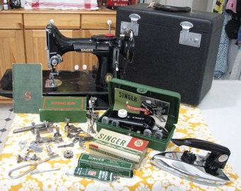 1951 Singer 221 featherweight sewing machine with special centennial badge marking one hundred years and many extras in beautiful condition