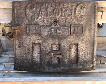 "rusty ""Fireless Caloric Furnace"" door No. 48 K"