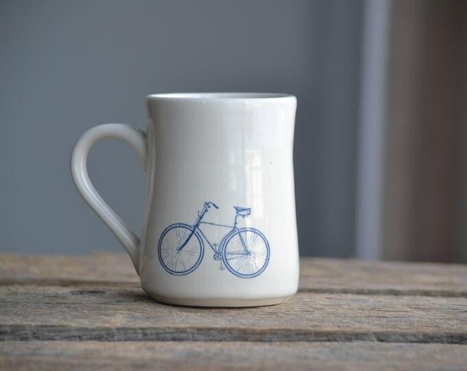 Blue bicycle white simple handmade pottery mug