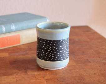 Carved porcelain waves cup in Mint. Coffee cup, tea cup, tumbler, whiskey glass, mug.