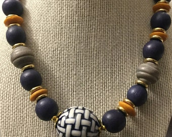 Necklace made with wood beads and glass pendant