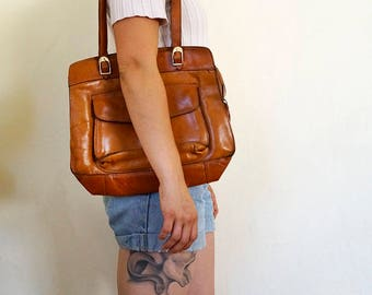 bright brown leather shoulder with zip closure