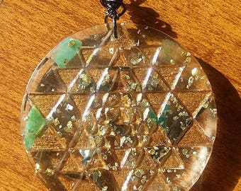 sri yantra orgone pendant//2 inches//sacred geometry//resin casted//orgone energy//black kyanite//moss agate//silver and gold//pyrite//topaz