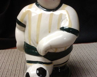 Soccer player coin bank by Clay Art made in Japan in 1990