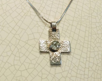 STERLING SILVER  CROSS. Modern textured sterling silver cross with white topaz
