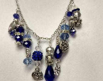 Sapphire blue and silver charm necklace