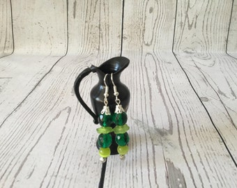 Silver earrings with forest green and mint green flower cap beads.
