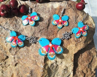 Blue and pink orchids set made of polymer clay.