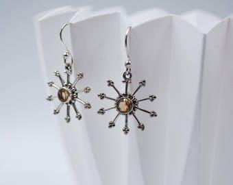 Amber sunburst silver and topaz earrings