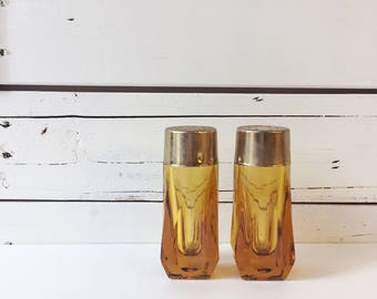 Vintage amber glass salt and pepper shakers.