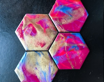 Set of four hexagonal coasters with fluorescent magenta, iridescent blue and shimmering gold with a glossy resin finish | Custom coaster set