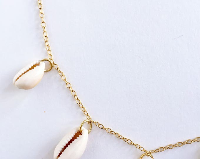 Cowrie shell golden necklace