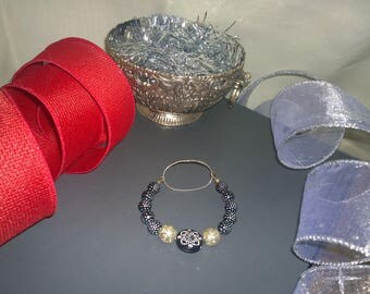Silver & Black Sparkle Bracelet Wire wrapped closure Loop onto bracelet's loop. Semi-stiff wire, plastic metal-like beads