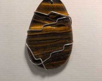 Tiger Eye Pendant with Silver wire and a 24 inch 925 Silver-filled chain.  TE 1
