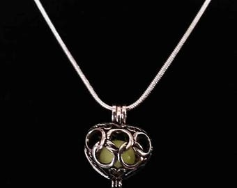 Glow in the dark love of Atlantis necklace