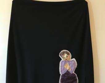 Appliquéd black skirt
