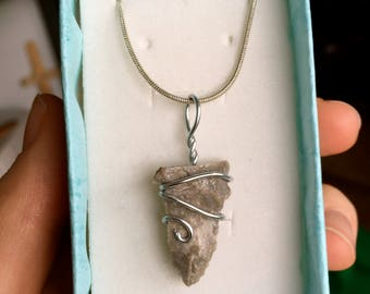 Flint arrowhead pendant with silver wire-wrapped design
