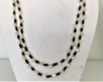 Fresh water pearl with black and gold beaded necklace