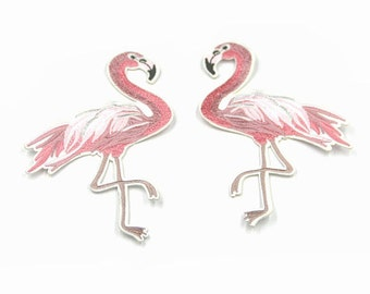 A pair of pretty pink embroidered flamingo iron on patch