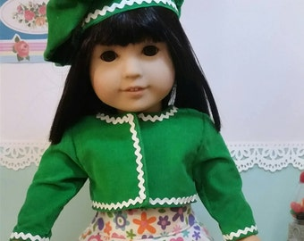 Green jacket with matching beret, flower skirt and shoes