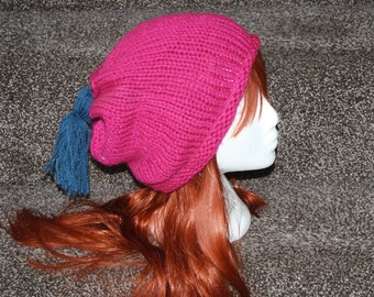 A hand knitted slouchy, beanie hat.