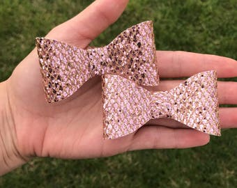 Pink and gold pigtail bows