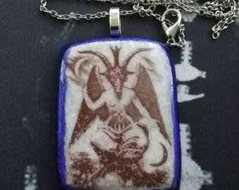 Custom kiln fired aged Baphomet glass pendant.
