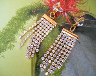 Earrings, gold and Crystal rhinestone chain.