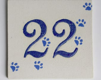 Stoneware number 22, bedroom entry door cat paws