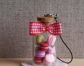 Vial with macaroons and cartons