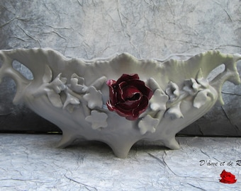 Grey planter with pink plum