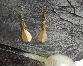 Dangling earrings with Golden hooks, a drop pendant curved gold and golden flowers beads.