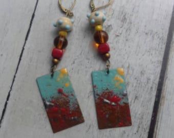 Derzou Ouzala earrings copper enamel red, yellow, sky blue and burnt Earth