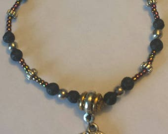 Elephant charm on lava stone bracelet with beautiful glass beads
