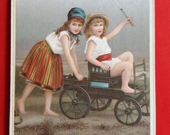 Kids Chromo in carriage card street advertising 1920 haberdashery shop