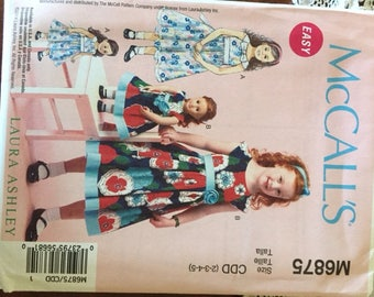 Girl's partydress and matching dolldress pattern uncut