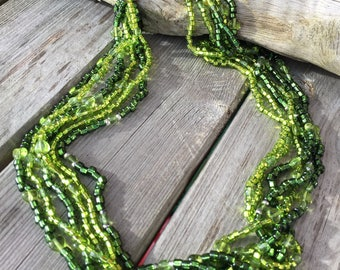 Green glass beaded six string necklace