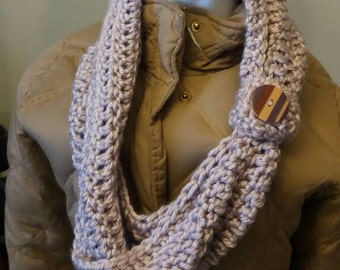 Infinity scarf with removable button.
