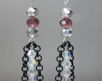 Handmade earrings made of Swarovski crystals and black chain.