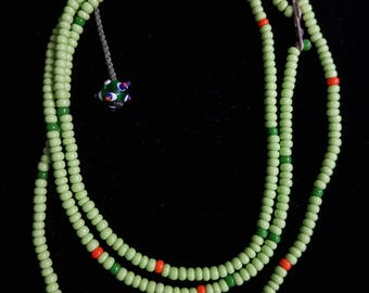 Green venetian beads necklace with silver lock