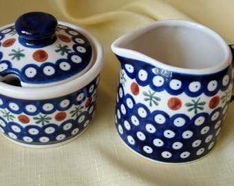 Vintage Boleslawiec Poland Hand Made Pottery Creamer w lidded Sugar Bowl. Set is Adorned in Cobalt Blue White  Rust  and Green