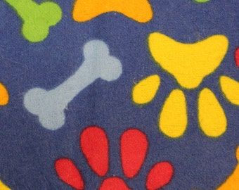 "Bright Paw and dog bone print on dark blue 100% Flannel cotton fabric   42""-44"""