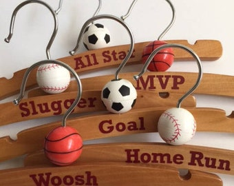 Baby and Toddler clothing hangers topped with rubber sports balls