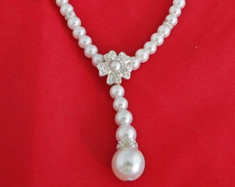 "Vintage 19"" white pearl and rhinestone necklace with 2"" center piece in great condition"